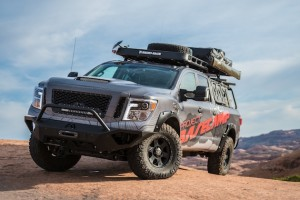 The Nissan TITAN XD PRO-4X Project Basecamp, designed for self-sustaining exploration of backcountry, is capable of taking on any climate or terrain in its path. It's built on the foundation of a rugged Nissan TITAN XD PRO-4X, anchored by a powerful Cummins® 5.0L V8 Turbo Diesel rated at 310 horsepower and a hefty 555 lb-ft of torque. Key modifications include 3-inch lift kit, bed cage, stargazer tent, light bar and 35-inch tires.